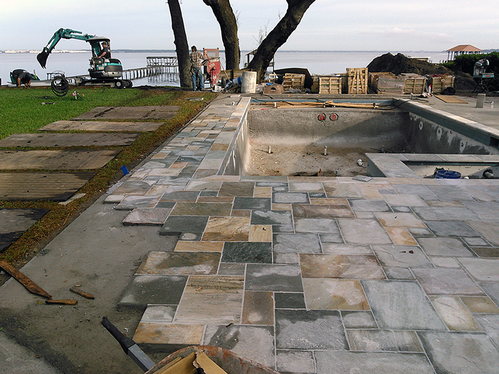Natural stone pool decking ek masonry inc ek masonry inc for Landscaping rocks jacksonville